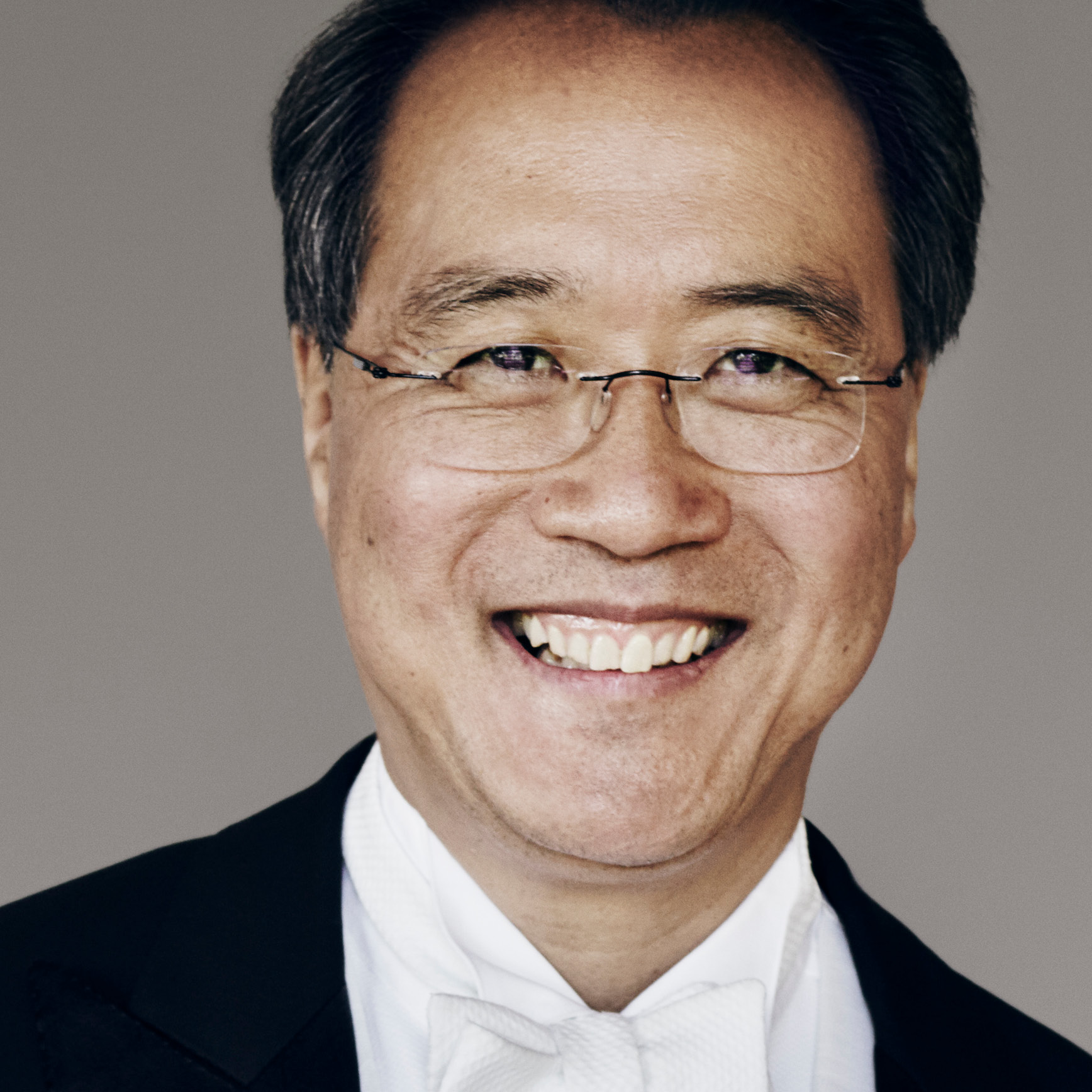 Close up photo of Yo-Yo Ma smiling