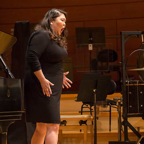 Young woman on stage in Helzberg Hall during a vocal workshop with the Kansas City Symphony