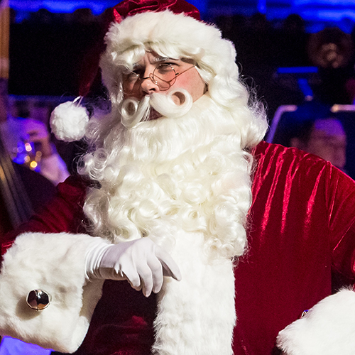 Santa Claus performing at the Symphony Christmas Festival