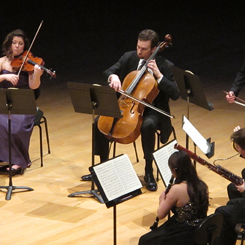 4 musicians performing in a quartet on stage in Helzberg Hall