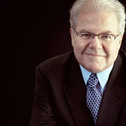 Pianist Emanuel Ax wearing a black sport coat and tie