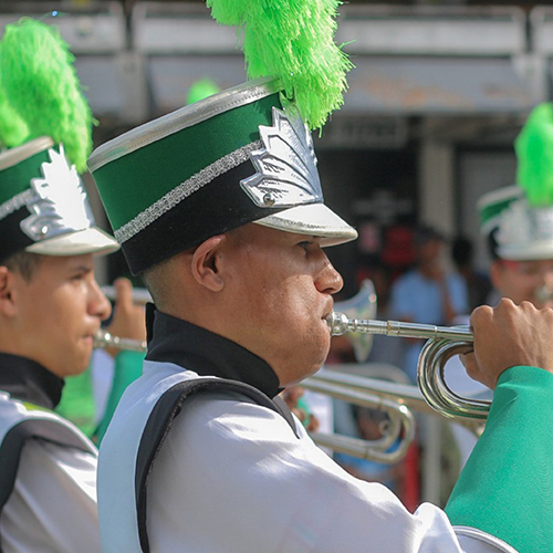 Photo of a marching band with a trumpet player in the foreground