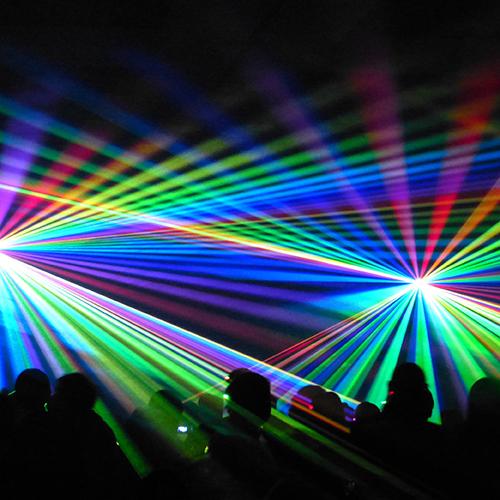 Image of laser lights above a crowd