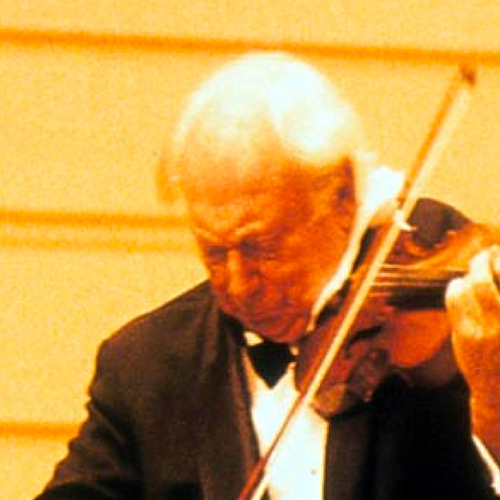 Film still of Violinist Isaac Stern performing on his violin wearing a black tuxedo and bow tie
