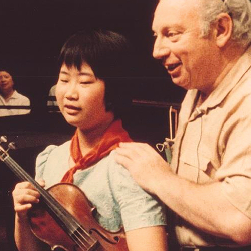 Film still of Isaac Stern with a young Chinese boy from the movie Mao to Mozart, Isaac Stern in China